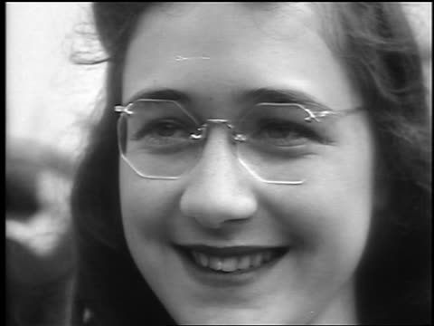 B/W 1941 close up woman with eyeglasses smiles / Palisades Park NJ / newsreel