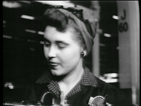 stockvideo's en b-roll-footage met b/w 1944 close up woman with kerchief on head riveting in defense plant / world war ii / industrial - first line of defense filmtitel
