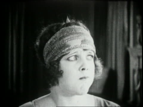 b/w 1924 close up woman with mouth full making face - disgust stock videos & royalty-free footage