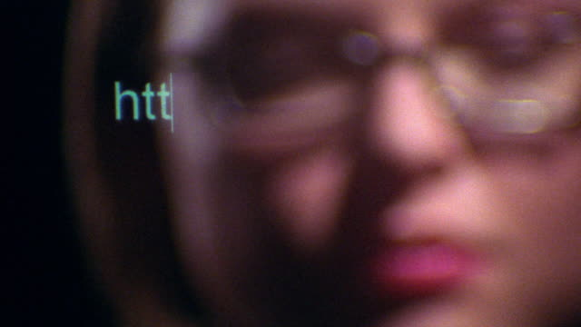 "soft focus close up pan woman's face with clear computer screen typing ""http://www."" - soft focus stock videos & royalty-free footage"