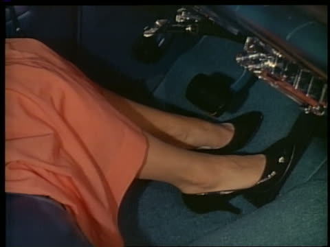1957 close up woman's foot pressing gas pedal in Chevrolet Impala