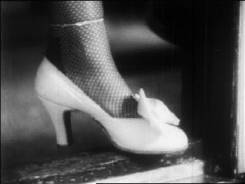 stockvideo's en b-roll-footage met b/w 1932 close up woman's foot with fishnet stockings stepping in high heels / feature - panty