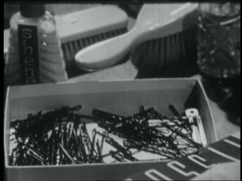 b/w 1953 close up woman's hand grabbing bobby pins from box - hair accessory stock videos & royalty-free footage