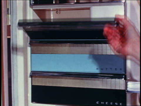 1958 close up woman's hand opening butter compartments in door of refrigerator - 1958 stock videos & royalty-free footage