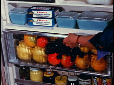 1958 close up woman's hand opening filled fruit bin in door of refrigerator - 1958 stock videos & royalty-free footage