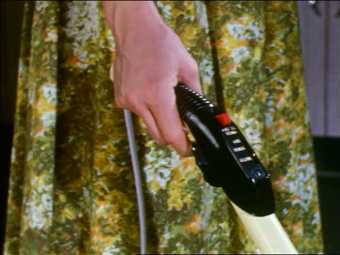 1959 close up woman's hand releasing lever on handle of floor polisher/vacuum cleaner / industrial - 1950 1959 stock videos & royalty-free footage