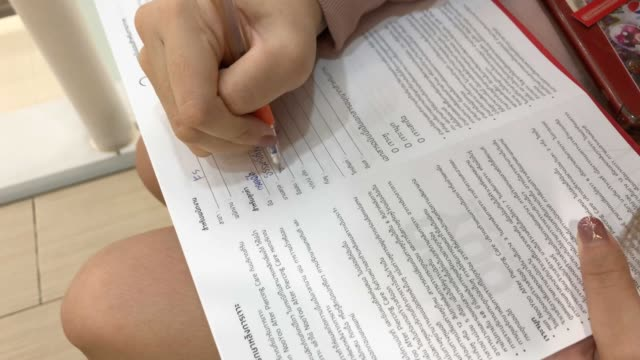 close up woman's hand signing contract - form document stock videos and b-roll footage