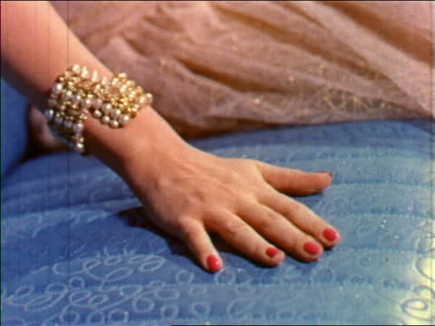 1955 close up woman's hand with bracelet rubbing seat of car / industrial - jewellery stock videos & royalty-free footage