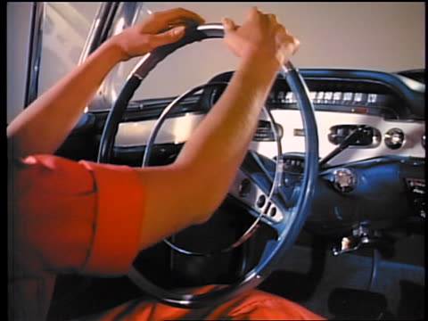 1958 close up woman's hands caressing steering wheel of chevrolet impala / commercial - 1958 stock-videos und b-roll-filmmaterial