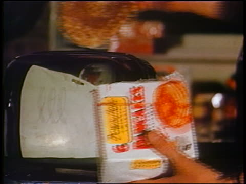 1958 close up woman's hands taking frozen pancakes from package + putting them into toaster