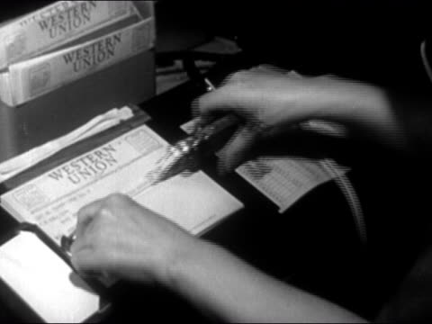 1946 close up woman's hands taping message on western union telegram - telegram stock videos and b-roll footage