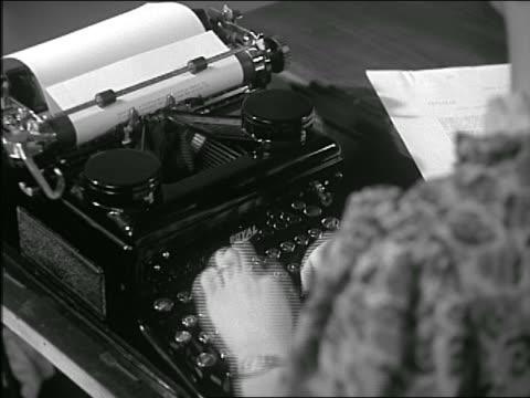 b/w close up woman's hands typing on manual typewriter - typewriter stock videos & royalty-free footage
