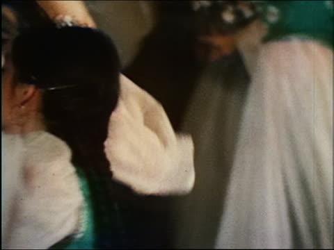 vídeos de stock e filmes b-roll de 1967 close up women dancing with elaborate arm movements / uzbekistan - braço humano
