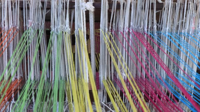 close up women hand weaving silk in thailand - woven stock videos & royalty-free footage