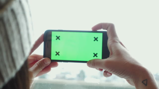 Close Up women Holding Blank Smart phone with Green on the train