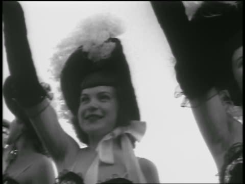 b/w 1954 close up pan women in costumes waving outdoors / newsreel - 1954 stock videos and b-roll footage