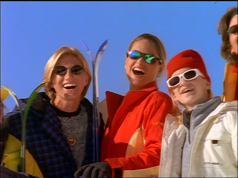 vídeos y material grabado en eventos de stock de close up pan women in ski gear + sunglasses smiling at camera - 1990