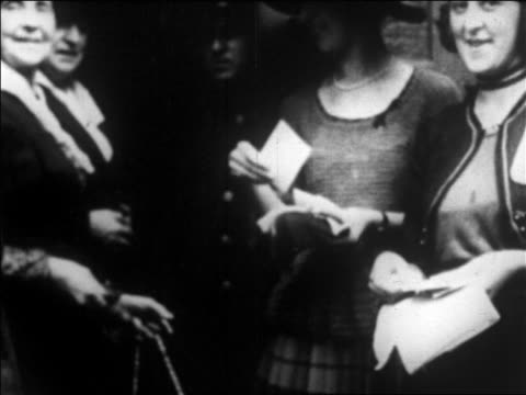 b/w 1920 close up women suffragettes handing out pamphlets in campaign to get the vote / newsreel - women's issues stock videos & royalty-free footage