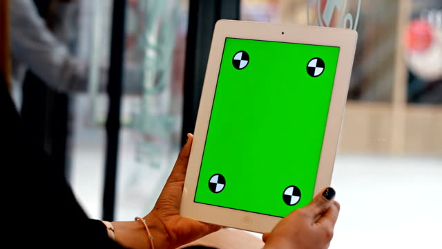 Close Up women using tablet  with green screen