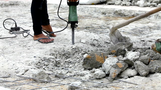 close up worker man drilling cement concrete road for put the plumbing - interconnect plug stock videos & royalty-free footage