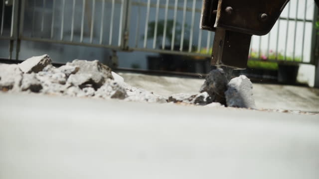 close up worker working and under construction building with cement truck - cement stock videos & royalty-free footage