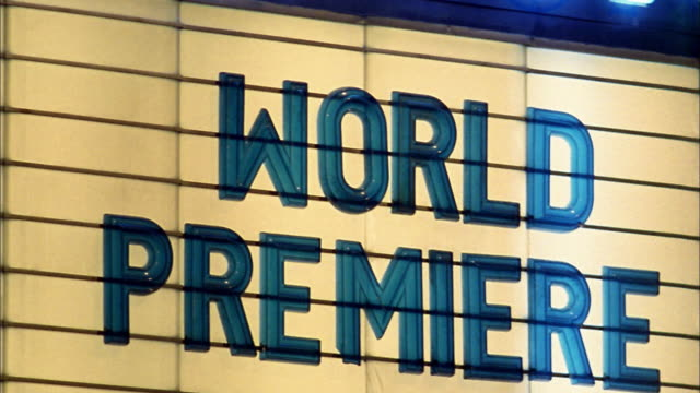 Close up 'world premiere' sign on movie theater marquee / Seattle, Washington
