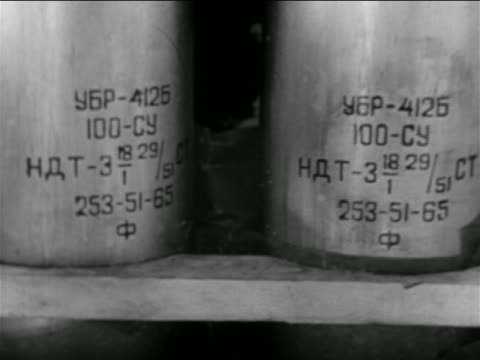 stockvideo's en b-roll-footage met b/w 1956 close up writing on ammunition / middle east / suez crisis / newsreel - 1956