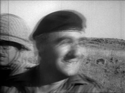 b/w 1967 close up yitzhak rabin in military beret smiling outdoors / six day war / newsreel - sechstagekrieg stock-videos und b-roll-filmmaterial