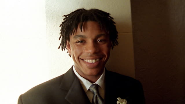 Close up young Black man in formal attire smiling