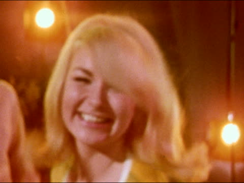 vidéos et rushes de 1968 close up young blonde woman smiling and dancing at party with streamers hanging from ceiling - teenage girls