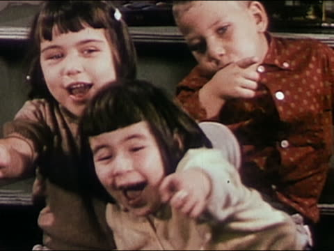 1955 close up young children laughing and pointing / audio - 1950 stock videos & royalty-free footage