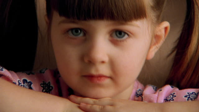 close up young girl leaning chin on hands - serious stock videos & royalty-free footage