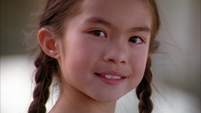 close up young girl smiling at cam - one girl only stock videos & royalty-free footage