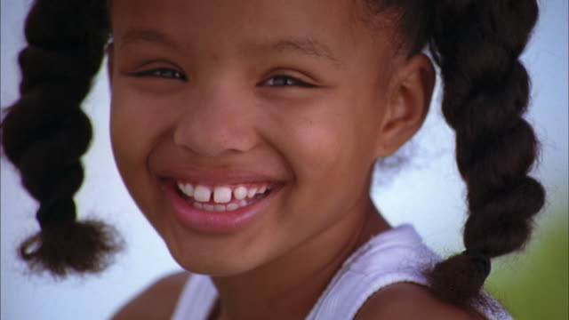 close up young girl w/pigtails smiling at cam - pigtails stock videos & royalty-free footage