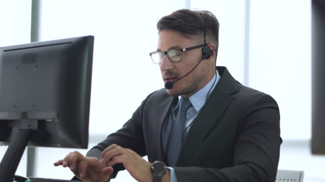 close up young man operator agent with headsets working in a call center - it professional stock videos & royalty-free footage