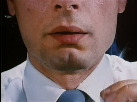 1987 close up young man's nose and mouth while taking drag on cigarette + coughing - smoking issues stock videos and b-roll footage