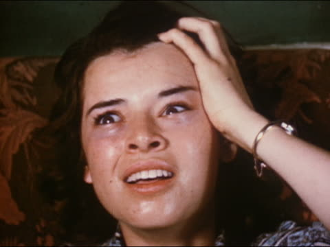 1951 close up young woman high on heroin looking around with dazed expression - sweat stock videos & royalty-free footage