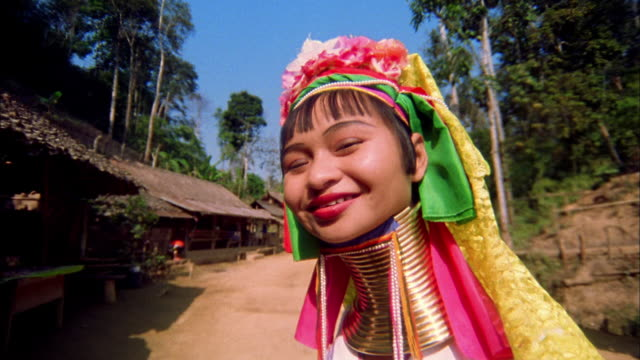 close up young woman of long-necked karen tribe (padaung) with neck rings / thailand - neck stock videos & royalty-free footage