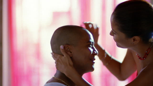 close up young woman rubbing young man's bald head / kissing him - shaved head stock videos & royalty-free footage