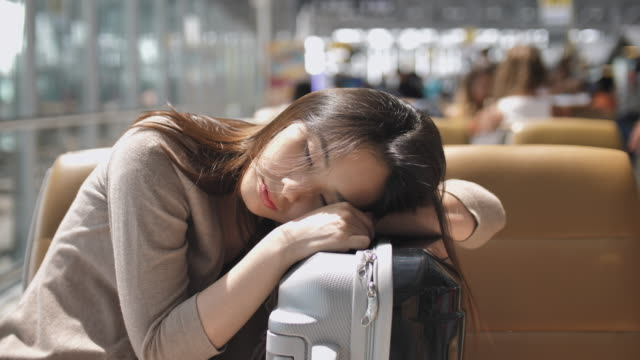 Close up Young woman Sleep At The Airport waiting for her flight