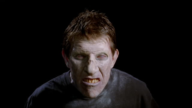 close up zombie looking at camera / grimacing - zombie stock videos & royalty-free footage