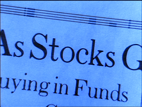 blue close up zoom in montage of financial pages - quotazione di borsa video stock e b–roll