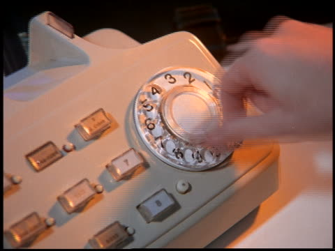close up zoom in of man's hand dialing on rotary telephone / brazil - 1997 stock-videos und b-roll-filmmaterial