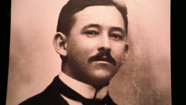 SEPIA close up zoom in PORTRAIT archival photograph of Hispanic man with mustache