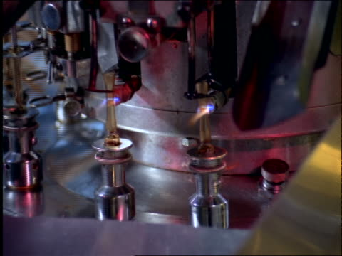 close up zoom in rotating machine cutting test tubes with torch in factory / pharmaceutical industry / brazil - 1997 stock videos and b-roll footage