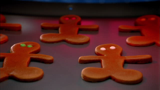 close up zoom in to extreme close up of  time lapse gingerbread men baking in oven - biscuit stock videos and b-roll footage
