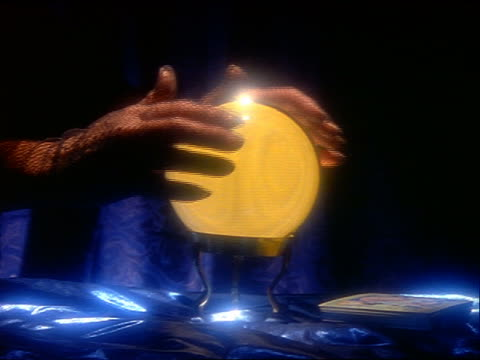 close up zoom in woman's hands wearing fishnet gloves rubbing yellow crystal ball - fishnet stock videos and b-roll footage