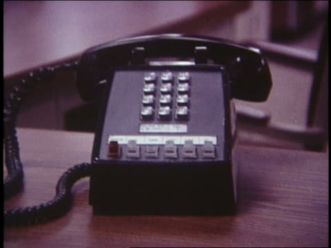 1970 close up zoom out button lit on touch tone telephone - landline phone stock videos & royalty-free footage