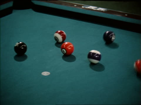 vídeos de stock e filmes b-roll de 1963 close up zoom out cue ball breaking up balls on pool table / industrial - mesa de bilhar