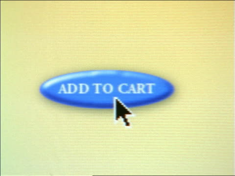 """close up zoom out cursor on computer screen pushing """"add to cart"""" button next to animated shopping cart - the internet stock videos & royalty-free footage"""